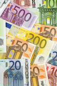 Many euro banknotes — Stock Photo