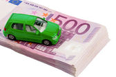 Green car on banknotes — Stock Photo