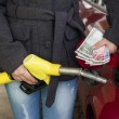 Woman at refuel at petrol station - Stock Photo