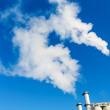Fuming industrial chimney — Stock Photo #24695383