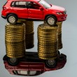 Rising motoring costs. car on coins — Foto de Stock