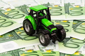 Tractor on euro banknotes — Stock Photo