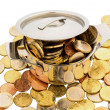 Saucepan and euro coins - Stock Photo