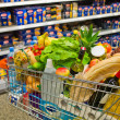 Shopping cart in a supermarket — Stock Photo #24701081
