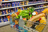 Shopping cart in a supermarket — Stok fotoğraf
