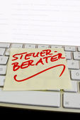 Note on computer keyboard: accountants — Stock Photo