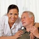 Nurse in elderly care for seniors in nursing homes — Stock Photo #25444779