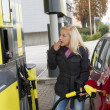Woman at refuel at petrol station — Stock Photo