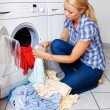 Stock Photo: Housewife with washing machine