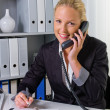 Stock Photo: Womwith phone in office