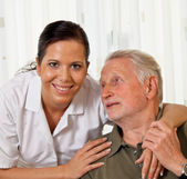 Nurse in elderly care for seniors in nursing homes — Stock Photo