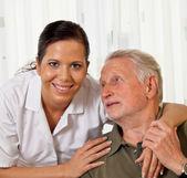 Nurse in elderly care for seniors in nursing homes — Stock Photo