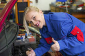 Woman as a mechanic in auto repair shop — Stock Photo
