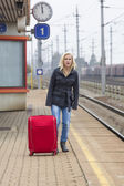 Woman waiting for train station on their — Stock Photo
