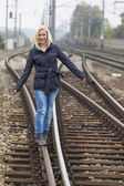 Woman balancing on railway. decisions — Stock Photo