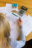 Woman with debts and bills — Stock Photo