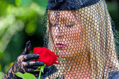Widow with veil and rose — Stock Photo
