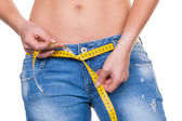 Woman with measuring tape before the next diet — Stock Photo