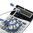 Stock Photo: Stethoscope and calculator