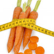 Stock Photo: Fresh carrots with tape measure