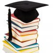 Mortarboard on books stack — Stock Photo #26175753