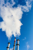 Fuming industrial chimney — Stock Photo