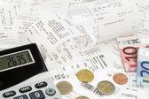 Calculator, receipts, bills — Stock Photo
