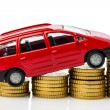 Car and coins — Stock Photo
