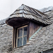 Old house with dormer and shingles — Stock Photo
