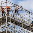 Foto Stock: Construction worker on scaffold