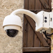 Surveillance camera on a wall — Foto de Stock