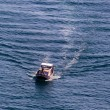 Стоковое фото: Fishing boat on way to sea