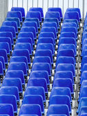 Grandstand with blue chairs — Stock Photo