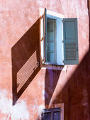 House with windows and shutters — Stock Photo