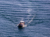 Fishing boat on the way to the sea — Foto de Stock