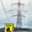 Power line and stop sign — Stock Photo #28013311
