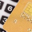 Golden credit card and calculator — Stock Photo