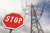 Power line and stop sign — Stock Photo