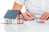 Woman signs agreement for house — Stock Photo