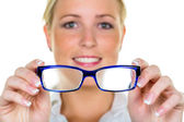 Woman holding glasses — Stock Photo