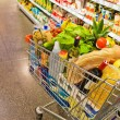 Shopping cart in a supermarket — Stock Photo #29837899