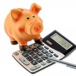 Red pencil, piggy bank and calculator — Stock Photo