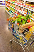 Shopping cart in a supermarket — Stock Photo
