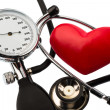 Stock Photo: Sphygmomanometer and heart