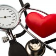 Sphygmomanometer and heart — Stock Photo