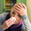 Sick woman with handkerchief — Stock Photo