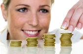 Woman stacking coins — Stock Photo