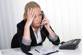 Woman with phone in stress — Stock Photo