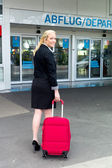 Businesswoman at airport — Stock Photo