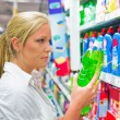 Woman buying cleaning supplies — Stock Photo #32660939